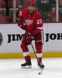 Brad Stuart plays with a puck during pre-game warmups before a preseason game.