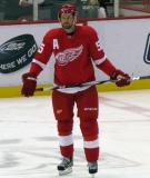 Niklas Kronwall stands in the neutral zone during pre-game warmups before a preseason game.