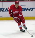Gustav Nyquist skates with the puck during pre-game warmups before a preseason game.