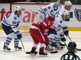 Chris Conner lines up for a faceoff in a preseason game against the Toronto Maple Leafs.  Colton Orr, Mike Brown, Cody Franson and Jonas Gustavsson oppose him.