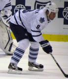 Toronto's Mike Komisarek lines up for a faceoff in a preseason game.