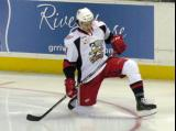 Trevor Parkes stretches in the right faceoff circle during pre-game warmups before a Grand Rapids Griffins game.