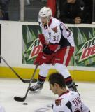 Brian Lashoff plays with the puck along the boards during pre-game warmups before a Grand Rapids Griffins game, with Tomas Tatar skating nearby.
