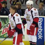 Logan Pyett and Chris Conner stand at the blue line during pre-game warmups before a Grand Rapids Griffins game.