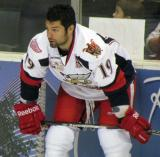Greg Amadio crouches along the boards during pre-game warmups before a Grand Rapids Griffins game.