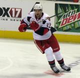 Brian Lashoff fires a pass during pre-game warmups before a Grand Rapids Griffins game.