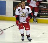 Logan Pyett stands near the boards during pre-game warmups before a Grand Rapids Griffins game.