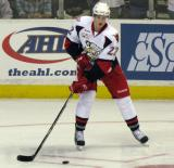 Louis-Marc Aubry plays with a puck during pre-game warmups before a Grand Rapids Griffins game.