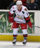 Gustav Nyquist crouches along the boards during pre-game warmups before a Grand Rapids Griffins game.
