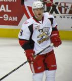 Willie Coetzee stands inside the blue line during pre-game warmups before a Grand Rapids Griffins game.