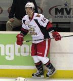 Sebastien Piche stands along the boards during pre-game warmups before a Grand Rapids Griffins game.