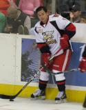 Francis Pare holds onto a puck along the boards during pre-game warmups before a Grand Rapids Griffins game.