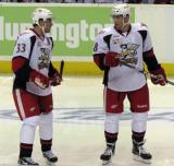 Doug Janik and Joakim Andersson talk before the opening faceoff of a Grand Rapids Griffins game.