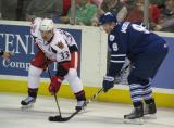 Doug Janik lines up against Toronto's Marcel Mueller during a Grand Rapids Griffins game.