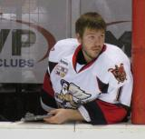Jordan Pearce charts faceoffs on the bench during a Grand Rapids Griffins game.
