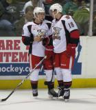 Willie Coetzee and Joakim Andersson talk strategy before a faceoff during a Grand Rapids Griffins game.