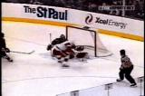 Pavel Datsyuk breaks in on Minnesota Wild netminder Dwayne Roloson and puts a backhand shot over his glove in the game's closing seconds.