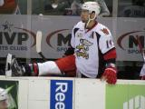 Greg Amadio stretches at the bench before the third period of a Grand Rapids Griffins game.