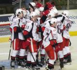 The Grand Rapids Griffins gather at their goal to celebrate a win in their 2011 home opener.