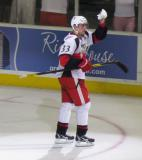 Doug Janik waves to the fans while taking a spin on the ice as the third star of the Grand Rapids Griffins' 2011 home opener.