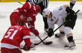 Henrik Zetterberg takes a faceoff against Anaheim's Ryan Getzlaf, with Valtteri Filppula on his right wing.