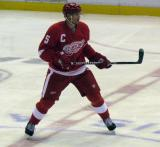 Nicklas Lidstrom straddles the center line while watching play develop.