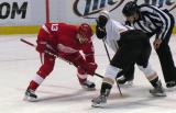 Pavel Datsyuk gets set for a draw against an Anaheim center.