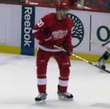 Drew Miller stands near the boards before a faceoff.