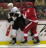 Danny Cleary collides with Anaheim's Toni Lydman along the boards.
