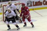 Fabian Brunnstrom goes to the front of Anaheim goalie Jonas Hiller's net, with Peter Holland keeping an eye on him.