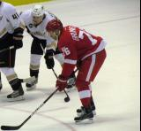 Fabian Brunnstrom lines up for a faceoff next to Anaheim's Matt Beleskey.