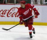 Mike Commodore skates through the Red Wings' zone.