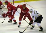 Nicklas Lidstrom and Johan Franzen line up on the left side of a defensive-zone faceoff, with Anaheim's Lubomir Visnovsky opposing them.