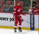 Jonathan Ericsson stands along the boards at the blue line during a stoppage in play.