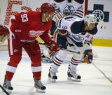 Johan Franzen lines up for an offensive-zone faceoff across from Edmonton's Ryan Smyth.