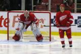 Jimmy Howard gets set in his crease as Ian White skates by before the start of the second period.