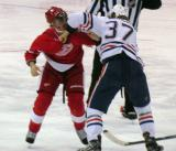 Justin Abdelkader and Edmonton's Lennart Petrell fight at the Detroit blue line.