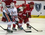 Drew Miller and Jakub Kindl line up opposite Edmonton's Ryan Jones for a defensive-zone faceoff.