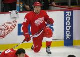 Fabian Brunnstrom kneels in front of the Detroit bench during pre-game warmups.