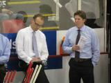 Assistant coach Jeff Blashill and head coach Mike Babcock watch pre-game warmups from the Detroit bench.
