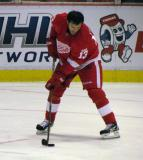 Pavel Datsyuk stickhandles in the right faceoff circle during pre-game warmups.