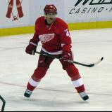 Jakub Kindl skates near the left faceoff circle during pre-game warmups.