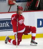 Justin Abdelkader stretches near the bench during pre-game warmups.