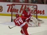 Fabian Brunnstrom fires a shot at Ty Conklin during pre-game warmups.