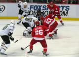 Darren Helm takes a faceoff against Dallas' Adam Burish.  Justin Abdelkader and Jiri Hudler flank Helm while Mark Fistric and Brenden Morrow line up with Burish.