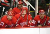 Brad Stuart, Jonathan Ericsson and Niklas Kronwall sit on the bench with backup goalie Ty Conklin behind them.