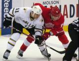 Justin Abdelkader lines up for a faceoff opposite Dallas' Jake Dowell.
