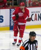 Pavel Datsyuk adjusts his chin strap during a stoppage in play.