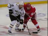 Tomas Holmstrom and Dallas' Brendan Morrow fight for position on a faceoff.