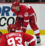 Henrik Zetterberg lines up at right wing for a faceoff, with Johan Franzen on the left wing.